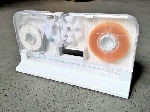 balicí stroj, lepící pásky, uzavírač sáčků, odvíječ lepící pásky, balička pečiva, obalové materiály do baliček